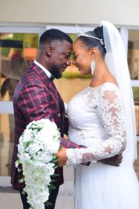 Henry Ipole flaunts his lovely wife in Grand style