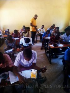 Zacks invigilating the scholarship exams organized by Ntezi People's Forum