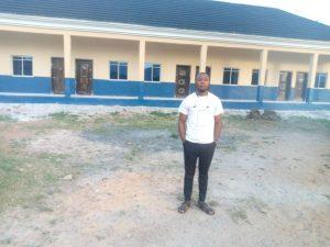 Zacks standing in the classroom block built in 2020